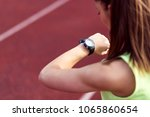 active female runner checking... | Shutterstock . vector #1065860654