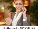 business woman talking on the... | Shutterstock . vector #1065882176