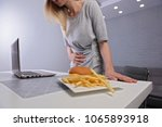 woman having stomachache... | Shutterstock . vector #1065893918