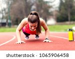 fit woman doing push ups at... | Shutterstock . vector #1065906458