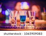 multicolored shots on bar | Shutterstock . vector #1065909083