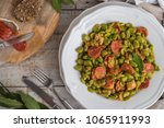 broad bean with chorizo on... | Shutterstock . vector #1065911993