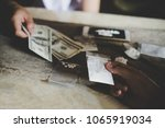 hand of addict man with money... | Shutterstock . vector #1065919034