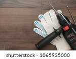 hammer drill and working gloves ... | Shutterstock . vector #1065935000