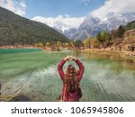 lady raise hand to be heart... | Shutterstock . vector #1065945806