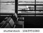 empty chairs in the departure... | Shutterstock . vector #1065951083