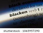 Small photo of blacken word in a dictionary. blacken concept.