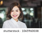 portrait of young asian woman  | Shutterstock . vector #1065960038