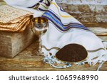 wine and matzoh jewish holiday  ...   Shutterstock . vector #1065968990