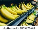 yellow bananas on store shelf.... | Shutterstock . vector #1065991673