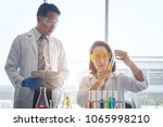 young female scientist standing ... | Shutterstock . vector #1065998210