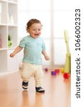 first steps of baby toddler... | Shutterstock . vector #1066002323