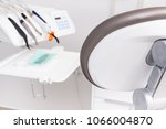 dental chair and accessories... | Shutterstock . vector #1066004870