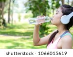 asian young woman drinking... | Shutterstock . vector #1066015619