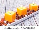 Three Orange Candles With...