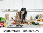 woman reading recipe for simple ...   Shutterstock . vector #1066025699