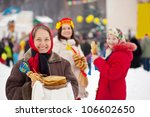 Mature woman with pancake during  Shrovetide at Russia - stock photo