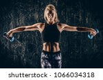 beautiful athletic woman doing... | Shutterstock . vector #1066034318