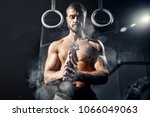 strong man with muscles claps... | Shutterstock . vector #1066049063