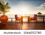 table and chairs at restaurant...   Shutterstock . vector #1066052780