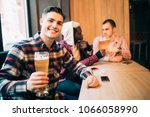 man drink beer in front of two... | Shutterstock . vector #1066058990