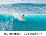 Surfer At The Top Of The Wave ...