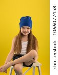 Small photo of Beautiful caucasian girl posing in studio on a Yellow background