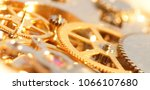 gold watch mechanism. | Shutterstock . vector #1066107680