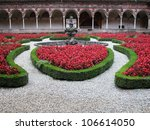 Cloister and flowers, Certosa di Pavia, Lombardy, Italy - stock photo