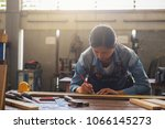 carpenter working on... | Shutterstock . vector #1066145273