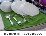 washed folded dishes on the... | Shutterstock . vector #1066151900
