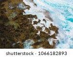 splashing wave on the shore ... | Shutterstock . vector #1066182893