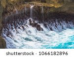 falling water on the shore ... | Shutterstock . vector #1066182896