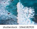 splashing wave with sea foam on ... | Shutterstock . vector #1066182920
