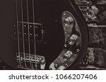 old bass guitar on brick wall... | Shutterstock . vector #1066207406