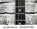 old bass guitar on brick wall... | Shutterstock . vector #1066207409