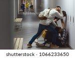 Stock photo frightened african american schoolboy being bullied in school corridor 1066233650