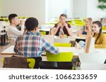 Stock photo group of teenage students chatting while taking lunch at school cafeteria 1066233659