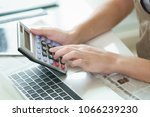 accountant using calculator and ... | Shutterstock . vector #1066239230