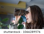 young woman spying out the... | Shutterstock . vector #1066289576