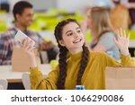 happy teen schoolgirl sitting... | Shutterstock . vector #1066290086