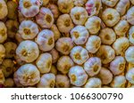 bunch of garlic hanging in a... | Shutterstock . vector #1066300790