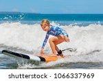 happy baby girl   young surfer... | Shutterstock . vector #1066337969
