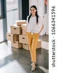 happy young businesswoman... | Shutterstock . vector #1066341596