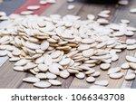 white raw pumpkin seeds on a... | Shutterstock . vector #1066343708