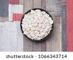 white raw pumpkin seeds in a... | Shutterstock . vector #1066343714