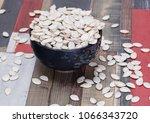 white raw pumpkin seeds in a... | Shutterstock . vector #1066343720
