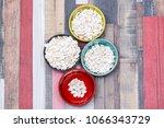 pumpkin seeds in colored bowls... | Shutterstock . vector #1066343729