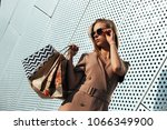 stylish young woman out shopping | Shutterstock . vector #1066349900