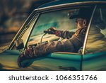 Cowboy Muscle Car Drive. Caucasian Men in His 30s Wearing Stylish Western Wear Taking Road Trip in His Classic Car. West American Ride in Style. - stock photo